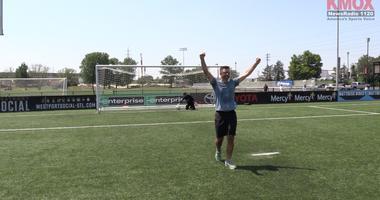 Mark Reardon celebrates scoring a goal, after the goalkeeper had his back turned.