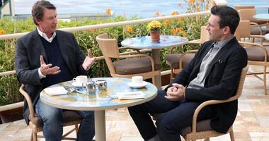 Jon Hamm sits with NHL legend Wayne Gretzky.