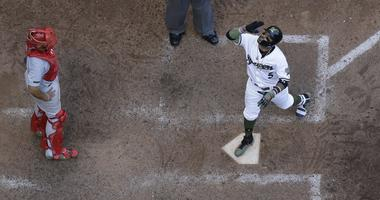 Milwaukee Brewers' Jonathan Villar celebrat6es after hitting a three-run home run during the seventh inning of a baseball game against the St. Louis Cardinals Monday, May 28, 2018, in Milwaukee.