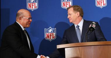 David Tepper, left, is greeted by as NFL commissioner Roger Goodall