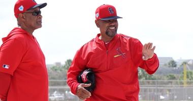 Ozzie Smith and Jose Oquendo run Cardinals infield practice.