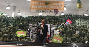 KMOX's Debbie Monterrey with pineapple display at Schnucks on Arsenal in St. Louis