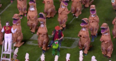 Iowa State marching band halftime performance using inflatable dinosaurs.