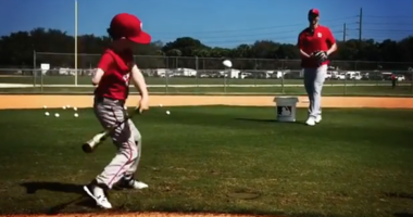 8-year-old Tommy Morrissey hits off Chris Carpenter of the Cardinals