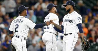 Seattle Mariners relief pitcher Alex Colome (48) bumps fists with shortstop Jean Segura