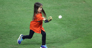 Hailey Dawson throws out the ceremonial first pitch before game four of the 2017 World Series between the Houston Astros and the Los Angeles Dodgers at Minute Maid Park.