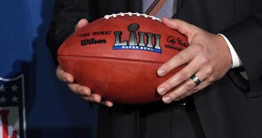 Atlanta Sports Council president Dan Corso holds a Super Bowl LIII logo football