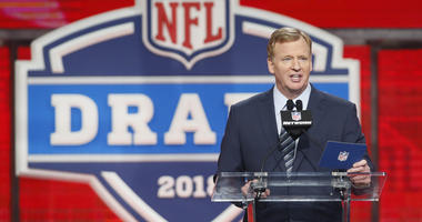 NFL commissioner Roger Goodell speaks at the podium in the first round of the 2018 NFL Draft