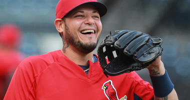 St. Louis Cardinals catcher Yadier Molina (4) reacts during batting practice