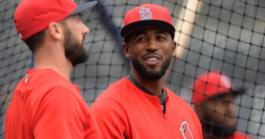 Dexter Fowler and Matt Carpenter talk before a St. Louis Cardinals game.