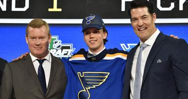 Dominik Bokk poses for a photo with team representatives after being selected as the number twenty-five overall pick to the St. Louis Blues in the first round of the 2018 NHL Draft