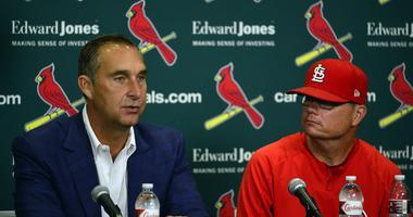 St. Louis Cardinals interim manager Mike Shildt (83) looks on as president of baseball operations John Mozeliak