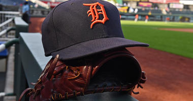 A general view of a Detroit Tigers cap and glove on the dugout railing