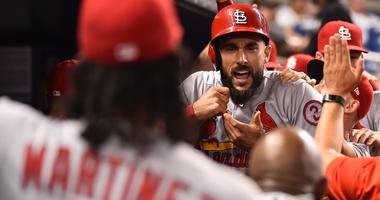 Aug 7, 2018; Miami, FL, USA; St. Louis Cardinals first baseman Matt Carpenter (13) celebrates in the dugout with teammates after hitting a solohome run in the eighth inning against the Miami Marlins at Marlins Park.