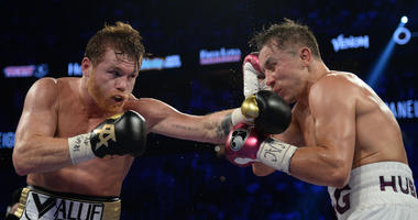 Canelo Alvarez (black trunks) and Gennady Golovkin (white trunks) box in the middleweight world championship boxing
