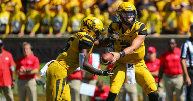 Missouri Tigers quarterback Drew Lock (3) hands off to running back Damarea Crockett