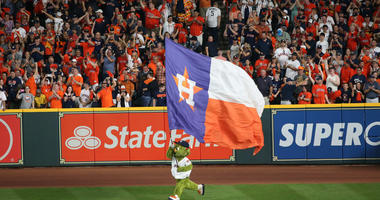 Houston Astros mascot Orbit flies a Astros flag