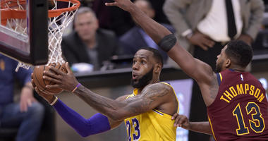 Los Angeles Lakers forward LeBron James (23) drives against Cleveland Cavaliers center Tristan Thompson