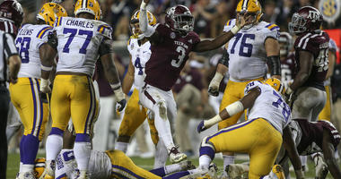 Texas A&M Aggies defensive lineman Tyree Johnson (3) reacts after tackling LSU Tigers quarterback Joe Burrow