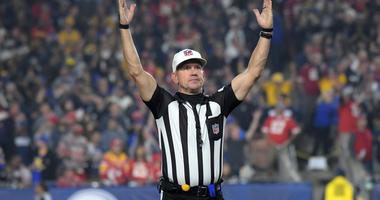 NFL referee Clete Blakeman (34) signals a touchdown