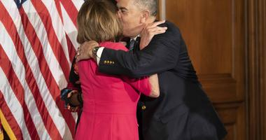 January 3, 2019; Washington, DC, USA; House Speaker Nancy Pelosi (D, CA), receives a hug and kiss from Rep. William Lacy Clay (D, MO) before his ceremonial swearing in to Congress on January 3, 2019 in Washington D.C.
