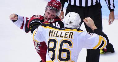 Arizona Coyotes center Joe Vitale (14) and Boston Bruins defenseman Kevan Miller