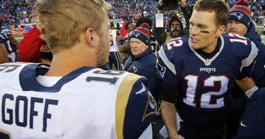New England Patriots quarterback Tom Brady (12) is congratulated by Los Angeles Rams quarterback Jared Goff