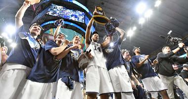 Villanova Wildcats forward Omari Spellman (14) hoist the national championship trophy
