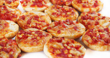 Shot of mini pizza bagels on white