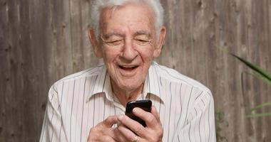 Old elder senior man on mobile smart phone