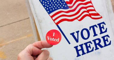 Voter Proudly Displays Evidence that He Voted on Election Day in the United States.