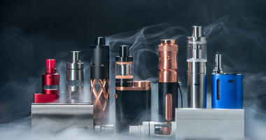 Electronic cigarette and smoke on black background