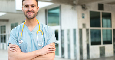 male nurse vet outdoors smiling
