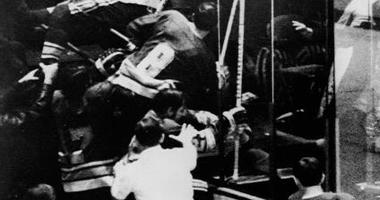 Members of the St. Louis Blues professional hockey team charge into the stands at the end of the second period to fight Philadelphia Flyers fans who threw trash at the Blues' coach, Al Arbour, Philadelphia, January 6, 1972.
