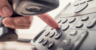 person dialing phone number