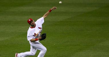 St. Louis Cardinals outfielder Rick Ankiel throws to the diamond after fielding a ball