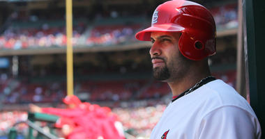 St. Louis Cardinals' Albert Pujols waits to bat against the Washington Nationals at Busch Stadium in St. Louis