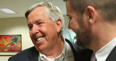 Mike Parson, left, celebrates his election as Lieutenant Governor of Missouri, on November 8, 2016, at the Oasis Convention Center in Springfield, Mo.