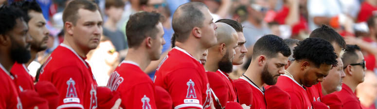 Grieving Angels beat Rangers 9-4 day after death of Skaggs