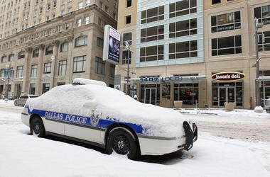 A Dallas Police car is covered in snow after a snowstorm hit the area February 4, 2011 in Dallas, Texas. More than four inches of snow fell overnight in the North Texas area. The Green Bay Packers will play the Pittsburgh Steelers in Super Bowl XLV on Feb