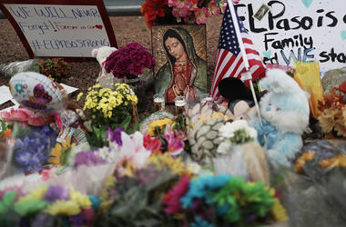 Flowers and mementos are seen at a makeshift memorial outside Walmart, near the scene of a mass shooting which left at least 20 people dead, on August 4, 2019 in El Paso, Texas. A 21-year-old male suspect was taken into custody in the city which sits alon