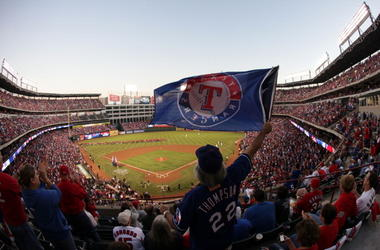 A fan waves a flag during Game Four of the MLB World Series between the St. Louis Cardinals and the Texas Rangers at Rangers Ballpark in Arlington on October 23, 2011 in Arlington, Texas.