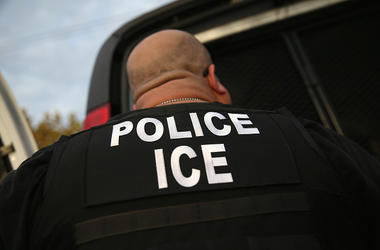 Immigration and Customs Enforcement (ICE), agents detain an immigrant on October 14, 2015 in Los Angeles, California. ICE agents said the immigrant, a legal resident with a Green Card, was a convicted criminal and member of the Alabama Street Gang in the