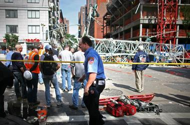 onstruction workers observe the scene of a crane collapse on Manhattan's Upper East Side at 91st Street and 1st Avenue May 30, 2008 in New York. The crane collapsed on top of an apartment building crashing into a penthouse apartment and falling to the gro