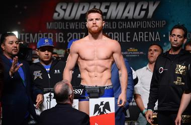 Canelo Alvarez weighs in for his upcoming bout against Gennady Golovkin (not pictured) during weigh-ins at MGM Grand Garden Arena.