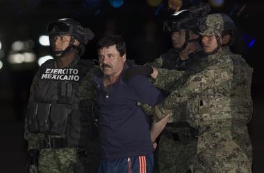 """Soldiers escort Joaquin Guzman Loera, alias """"El Chapo"""", upon his arrival to the hangar of the Attorney General's Office, in Mexico City, capital of Mexico, on Jan. 8, 2016"""