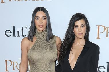"""HOLLYWOOD, CA - APRIL 12: Kim Kardashian and Kourtney Kardashian at the premiere of """"The Promise"""" at TCL Chinese Theatre on April 12, 2017 in Hollywood, California."""