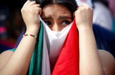 A fan reacts while watching a live broadcast of the 2018 FIFA World Cup round of 16 match between Brazil and Mexico, at the Zocalo Square in Mexico City, capital of Mexico, July 2, 2018. (Xinhua/Francisco Canedo) (da) (rtg) (ce)