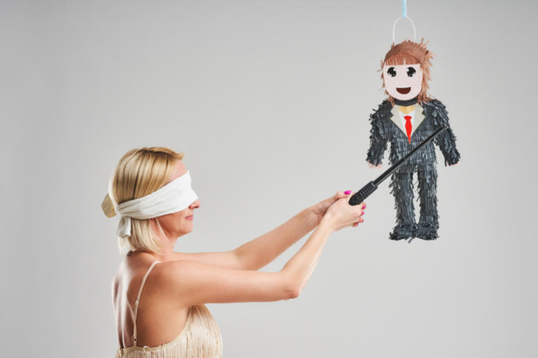 Picture of woman hitting male pinata over grey background