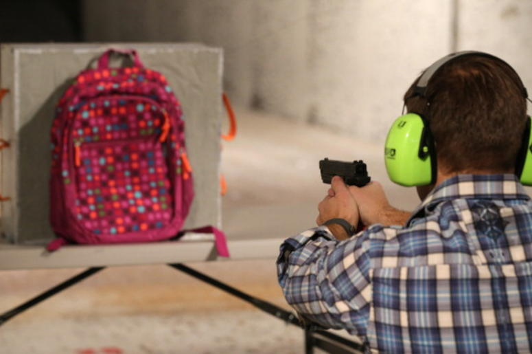Chief Operating Officer for Amendment II, Rich Brand, shoots a child's backpack with their Rynohide CNT Shield in it on December 21, 2012 in Salt Lake City, Utah. Their orders for the bulletproof shield have gone up dramatically since the school shooting